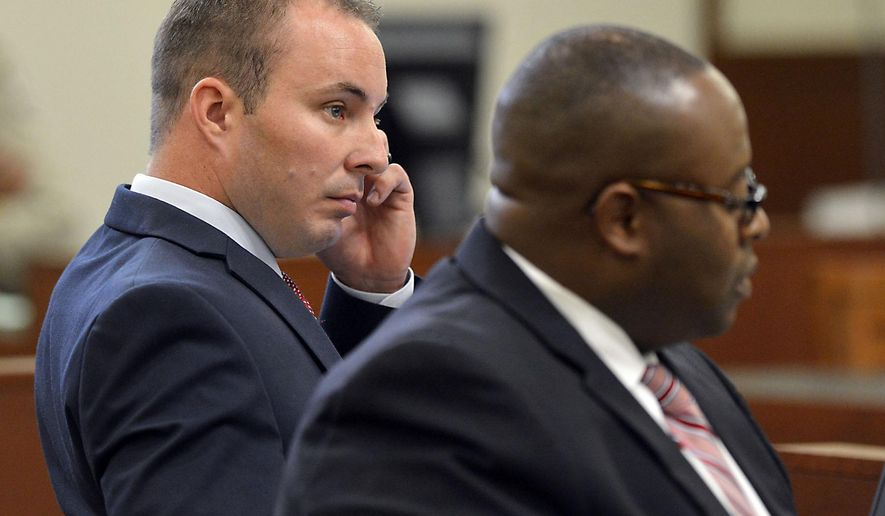 Police officer Randall Kerrick, left, and defense attorney Michael Greene listen during opening arguments at the Mecklenburg County Courthouse in Charlotte. N.C., Monday, Aug. 3, 2015. Kerrick is facing voluntary manslaughter charges in the shooting death of Jonathan Ferrell. (Davie Hinshaw/The Charlotte Observer via AP, Pool)