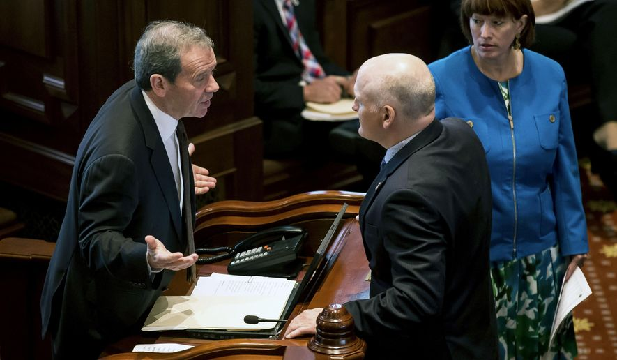 "FILE - In this July 15, 2015 file photo, Illinois state Senate President John Cullerton talks with Sen. Dan Kotowski, D-Park Ridge, center, and Sen. Heather Steans, D-Chicago, right, on the floor of the Senate at the state Capitol in Springfield, Ill. The Illinois Senate is expected to vote Tuesday, Aug. 4, 2015, on a measure to authorize the spending of $4.8 billion in federal dollars, much of which is considered ""pass-through"" money that doesn't require a match of state funds. A spokesman for Gov. Bruce Rauner said he supports the plan. The money would be used to fund programs that provide nutrition to women and children, help low-income residents pay their utility bills and offer cancer screenings to people who cannot afford them, among others. (Justin L. Fowler/The State Journal-Register via AP, File)  NO SALES, MANDATORY CREDIT"