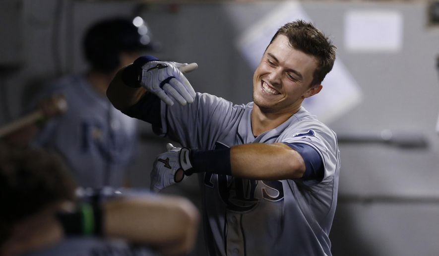 Tampa Bay Rays' Richie Shaffer pretends to be congratulated by teammates as they ignore him, after Shaffer got his first hit in the majors, a home run off Chicago White Sox relief pitcher Daniel Webb, during the seventh inning of a baseball game Tuesday, Aug. 4, 2015, in Chicago. (AP Photo/Charles Rex Arbogast)