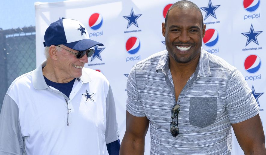 "Dallas Cowboys owner Jerry Jones, left, honors former safety Darren Woodson with the announcement of his induction into the ""Ring of Honor"" on Nov. 1, 2015 during Dallas Cowboys' NFL training camp, Tuesday, Aug. 4, 2015, in Oxnard, Calif. (AP Photo/Gus Ruelas)"