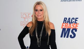 In this May 3, 2013, file photo, Kim Richards arrives at the 20th annual Race to Erase MS event in Los Angeles. Richards is out on bail after she was arrested on suspicion of shoplifting in Los Angeles. The 50-year-old reality TV star was jailed Sunday, Aug. 2, 2015, after being accused of taking about $600 in merchandise from a Target store in the Van Nuys area. (Photo by Jordan Strauss/Invision/AP, File)