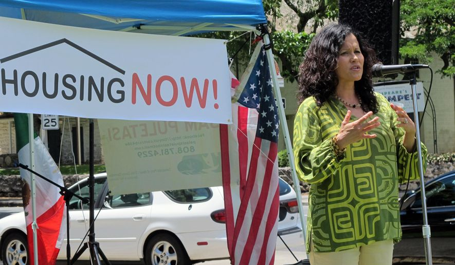 Honolulu City Councilwoman Kymberly Marcos Pine talks about her concerns about banning sitting and lying down on sidewalks at a rally Tuesday, Aug. 4, 2015, in Honolulu. A group of affordable housing advocates in Hawaii is calling on city and state leaders to take action on homelessness. (AP Photo/Cathy Bussewitz)