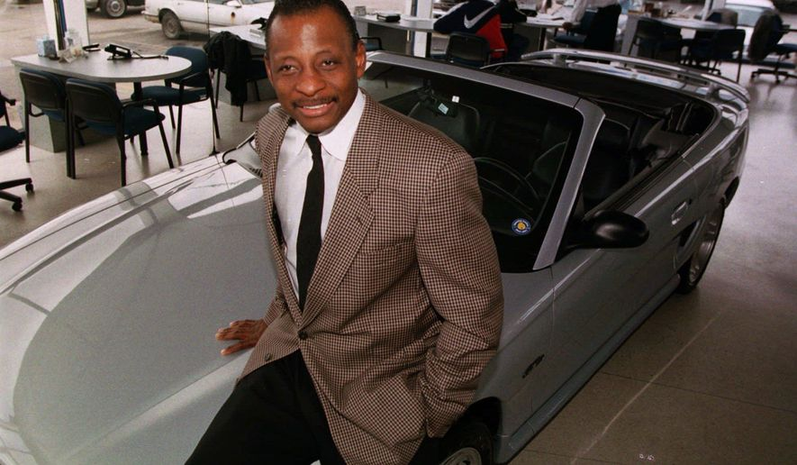 FILE - In this Sept. 30, 1997, file photo, Mel Farr poses in his showroom in Oak Park, Mich. Farr, the Detroit Lions' running back who rushed for over 3,000 yards in seven NFL seasons, has died. He was 70. A Lions spokesman said Farr's son confirmed his father died Monday, Aug. 3, 2015. After his NFL career, Farr went on to build an auto dealership business. (AP Photo/Carlos Osorio, File)