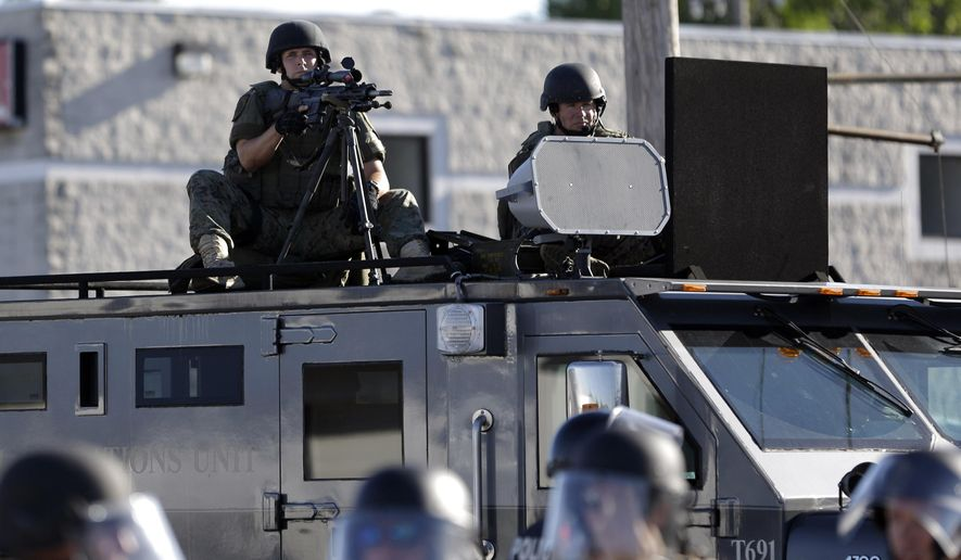 Under a program reinstated by President Trump on Monday, surplus military equipment will once again be available to state and local police departments across America. (Associated Press/File)