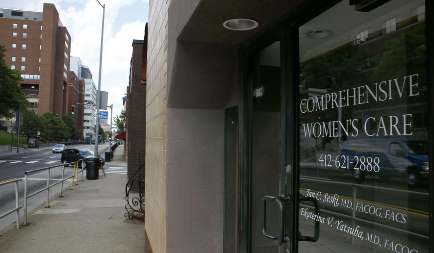The entrance to the office of Dr. Jan Casimir Seski, is seen Sunday, Aug. 2, 2015, in Pittsburgh. The Zimbabwe National Parks and Wildlife Management Authority accused Seski, whom they said is an American, of being involved in an illegal bow and arrow lion hunt in April. (AP Photo/Keith Srakocic)