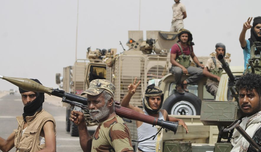 In this photo taken Monday, Aug. 3, 2015, fighters against Shiite rebels known as Houthis gather at the road leading to Al-Anad base near Aden in the southern province of Lahej, Yemen. The capture of the Al-Anad base was a significant victory for the forces allied to Yemen's exiled President Abed Rabbo Mansour Hadi in their battle to reverse the gains of Houthis. (AP Photo/Wael Qubady)