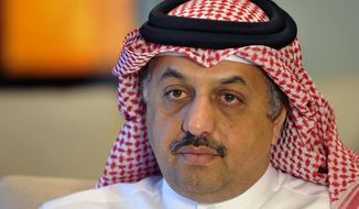 "Qatari Foreign Minister Khalid al-Attiyah talks to the Associated Press reporter during an exclusive interview at the Ministry of foreign Affairs, Tuesday, Aug. 4, 2015, in Doha, Qatar. Qatar's top diplomat on Tuesday called for a ""serious dialogue"" with Iran in the wake of its nuclear deal with world powers, even as he blasted Tehran for continuing to support Syria's embattled government. (AP Photo)"