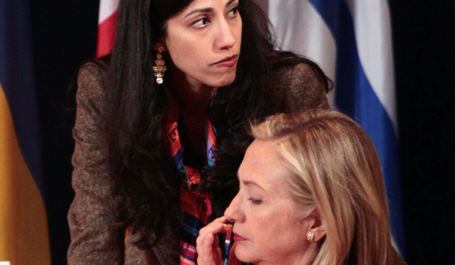 Huma Abedin, a longtime assistant to Hillary Rodham Clinton, has been under investigation for a $33,000 payout from the State Department. (Associated Press) ** FILE **