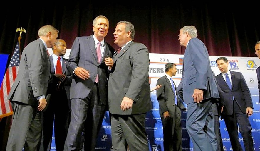 The GOP hopefuls in a convivial mood following their Monday night forum in New Hampshire. (ASSOCIATED PRESS)