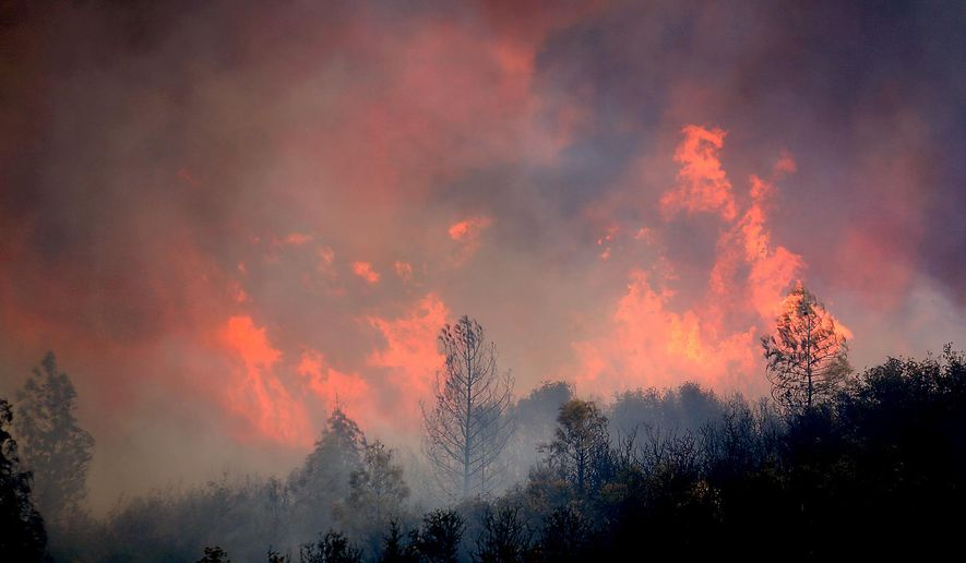 A fire burns to the north of U.S. Highway 20 east of Spring Valley in Lake County, Calif., Monday, Aug. 3, 2015. Firefighters were working aggressively to regain control after a raging California fire jumped a highway that had served as a containment line for the massive blaze, which is one of 20 wildfires burning in California. (Kent Porter/The Press Democrat via AP) MANDATORY CREDIT