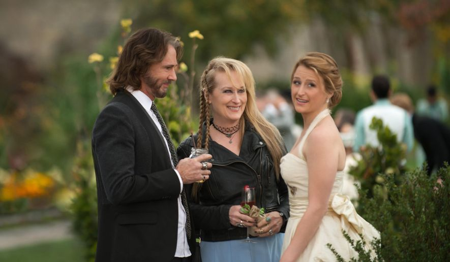 """This photo provided by courtesy of Sony Pictures shows, Rick Springfield, from left, as Greg, Meryl Streep, as Ricki, and Mamie Gummer as Julie, in TriStar Pictures' """"Ricki and the Flash."""" The movie opens in U.S. theaters on Aug. 7, 2015 and co-stars Ms. Streep's real-life daughter, Mamie. (Bob Vergara/Sony Pictures via AP)"""