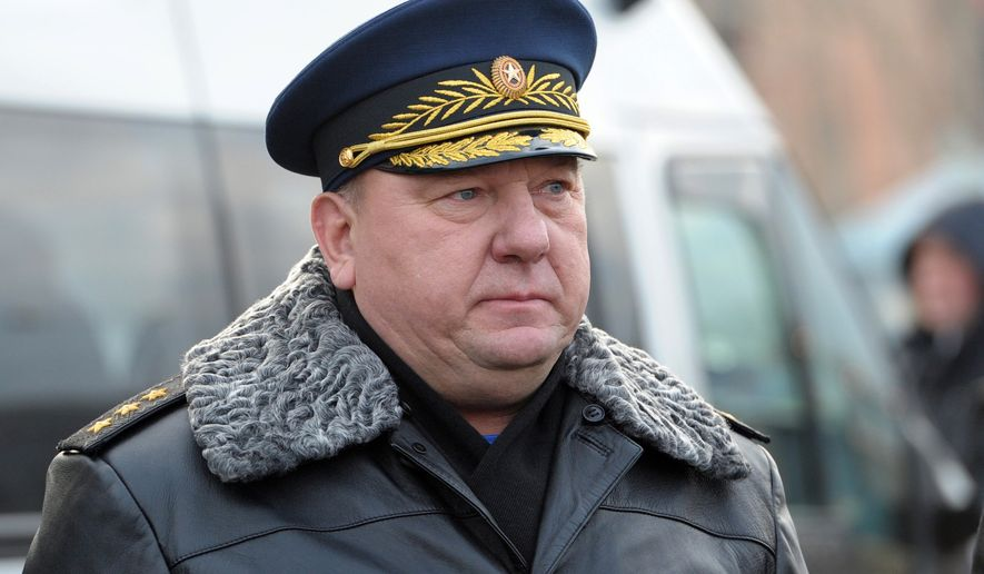 Commander of the Russian Airborne Forces Vladimir Shamanov stands during President Vladimir Putin's visit to  the airborne troops school in the city of Ryazan, some 100 km (62.5 miles) southeast of Moscow, Friday, Nov. 15, 2013. (AP Photo/RIA-Novosti, Alexei Nikolsky, Presidential Press Service)