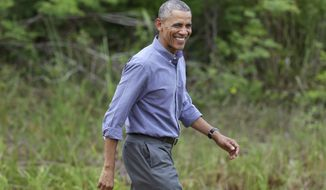 President Barack Obama arrives before making a statement after touring Everglades National Park on Earth Day, Wednesday, April 22, 2015, in Florida. Obama used the visit  to warn of the damage that climate change is already inflicting on the nation's environmental treasures. (AP Photo/Lynne Sladky)