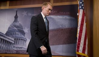 Sen. James Lankford, Oklahoma Republican, leaves a news conference on Capitol Hill in Washington on July 29, 2015, where Planned Parenthood was discussed. (Associated Press)