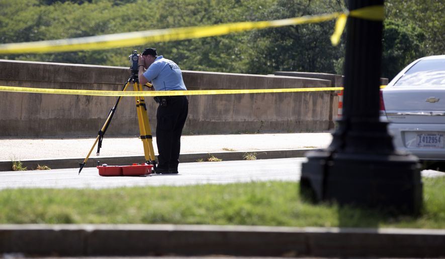 Members of the U.S. Park Police investigate at the site of a reported shooting near the National Mall in Washington on Tuesday, Aug. 4, 2015. (Associated Press)