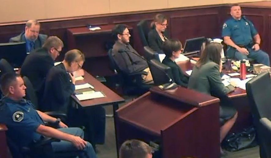 In this image made from Colorado Judicial Department video, James Holmes, fifth from left in dark shirt, sits in court on the first day of penalty phase 3 in his trial, in Centennial, Colo., on Tuesday, Aug. 4, 2015. The jury in the Colorado theater shooting trial will hear even more heart-wrenching testimony from those who lost loved ones in the attack, as prosecutors begin their final push to have Holmes sentenced to death. (Colorado Judicial Department via AP, Pool)