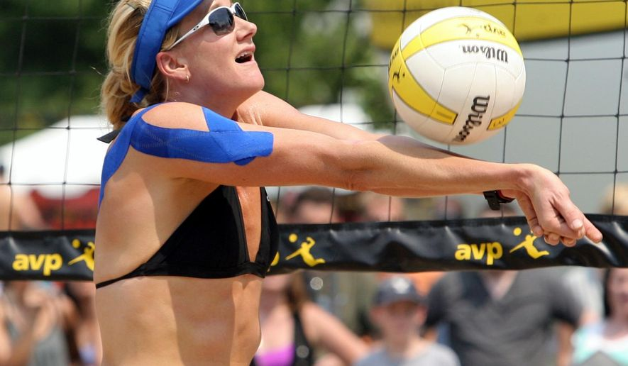FILE - In this Aug. 16, 2013, file photo, Kerri Walsh Jennings sets the ball during an AVP beach volleyball in Salt Lake City. With the Olympics a year away, the three-time beach volleyball gold medalist is recovering from a dislocated right shoulder that could get in the way of qualifying for the Rio Games.  (Rick Egan/The Salt Lake Tribune via AP, File) DESERET NEWS OUT; LOCAL TELEVISION OUT; MAGS OUT; MANDATORY CREDIT