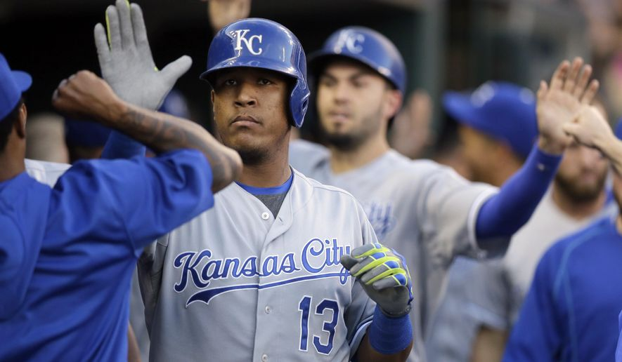 Kansas City Royals' Salvador Perez (13) is congratulated by teammates after he and Eric Hosmer scored on Perez's two-run home run off Detroit Tigers starting pitcher Justin Verlander during the fourth inning of a baseball game, Tuesday, Aug. 4, 2015, in Detroit. (AP Photo/Carlos Osorio)