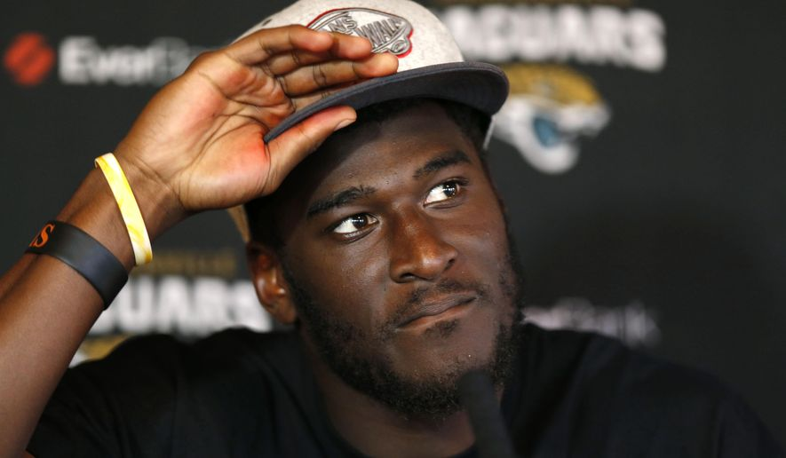 "FILE - In this Oct. 23, 2013 file photo, Jacksonville Jaguars wide receiver Justin Blackmon speaks to the media during a press conference at the Pennyhill Park Hotel and Spa in Bagshot, England. Jaguars general manager Dave Caldwell said Tuesday, Aug. 4, 2015, that he has a ""little bit of hope"" that the suspended receiver could return the team. But ""realistically I think when you're away from the game what you were once is not what you probably will be. Your skills do erode, especially if you're not staying in tip-top shape and you're not in football shape.""  (AP Photo/Sang Tan, File)"