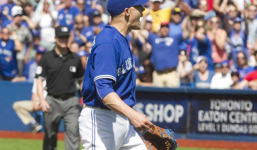 Toronto Blue Jays pitcher Aaron Sanchez reacts after being ejected from a baseball game against the Kansas City Royals for throwing at Royals batter Alcides Escobar in the eighth inning in Toronto, Sunday, Aug. 2, 2015. (Fred Thornhill/The Canadian Press via AP)