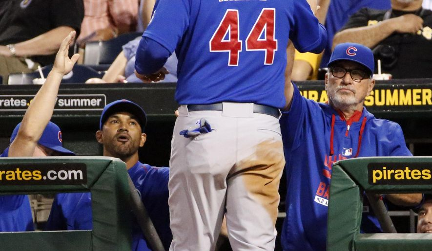 Chicago Cubs' Anthony Rizzo (44) is greeted by manager Joe Maddon, right, after scoring on a double by Starlin Castro off Pittsburgh Pirates relief pitcher Jared Hughes during the fifth inning of a baseball game in Pittsburgh, Tuesday, Aug. 4, 2015. (AP Photo/Gene J. Puskar)