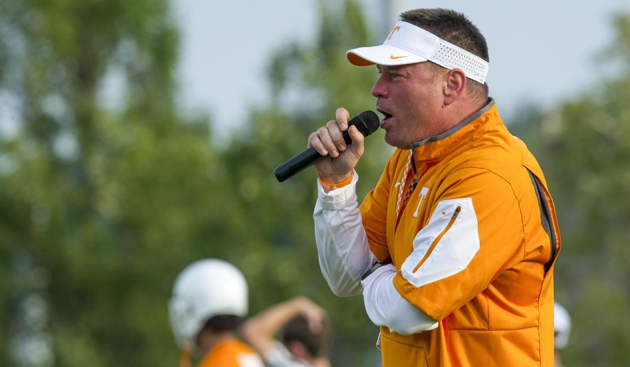 Tennessee head coach Butch Jones talks to his players during the University of Tennessee first fall session football practice at the University of Tennessee in Knoxville, Tenn. on Tuesday, Aug. 4, 2015. (AP Photo/Knoxville News Sentinel, Jessica Tezak) MANDATORY CREDIT