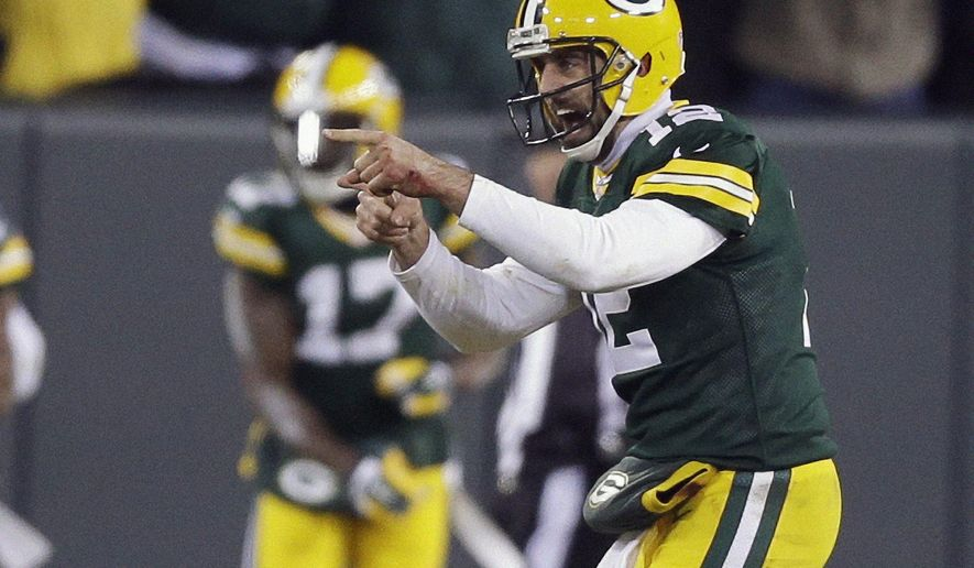 FILE - In this Nov. 30, 2014, file photo, Green Bay Packers quarterback Aaron Rodgers celebrates a 45-yard touchdown pass to Jordy Nelson during the first half of an NFL football game against the New England Patriots in Green Bay, Wis. With a healthy Rodgers ready to resume his pinpoint passing, the Bay Packers will start the season as the No. 1 team in the AP Pro32 power rankings. In balloting by the 12 media members who regularly cover the NFL, the Packers finished ahead of the Seattle Seahawks and New England Patriots. The next poll will be released on Sept. 15 after Week 1 of the regular season. (AP Photo/Tom Lynn, File)