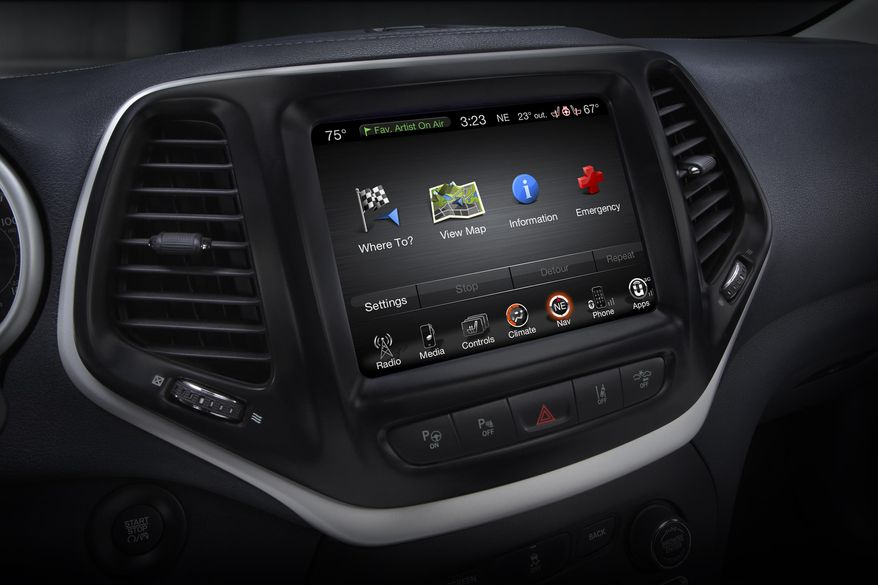 This product image provided by Fiat Chrysler Automobiles shows the Uconnect 8.4 inch infotainment system on a 2014 Jeep Cherokee Limited. Harman International, the company that makes car radios that friendly hackers exploited to take control of a Jeep Cherokee, on Tuesday, Aug. 4, 2015 said its other infotainment systems don't have the same security flaw. (Fiat Chrysler Automobiles via AP)