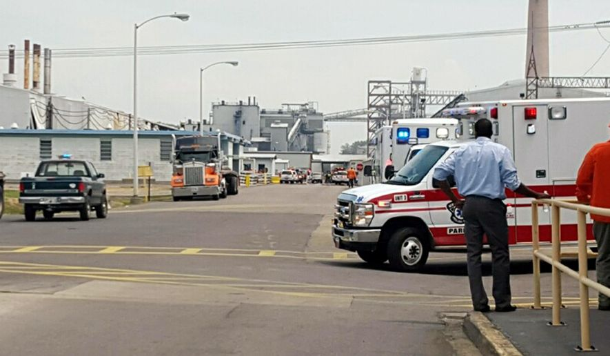 Emergency crews respond to an explosion at the Noranda Aluminum plant near Marston, Mo., Tuesday, Aug. 4, 2015. A company spokesman, who  called the blast a molten metal explosion, said about 20 people working in the area at the time and none were injured seriously. (Laura Simon/The Southeast Missourian via AP) LOCAL TV OUT; LOCAL RADIO OUT; LOCAL INTERNET OUT
