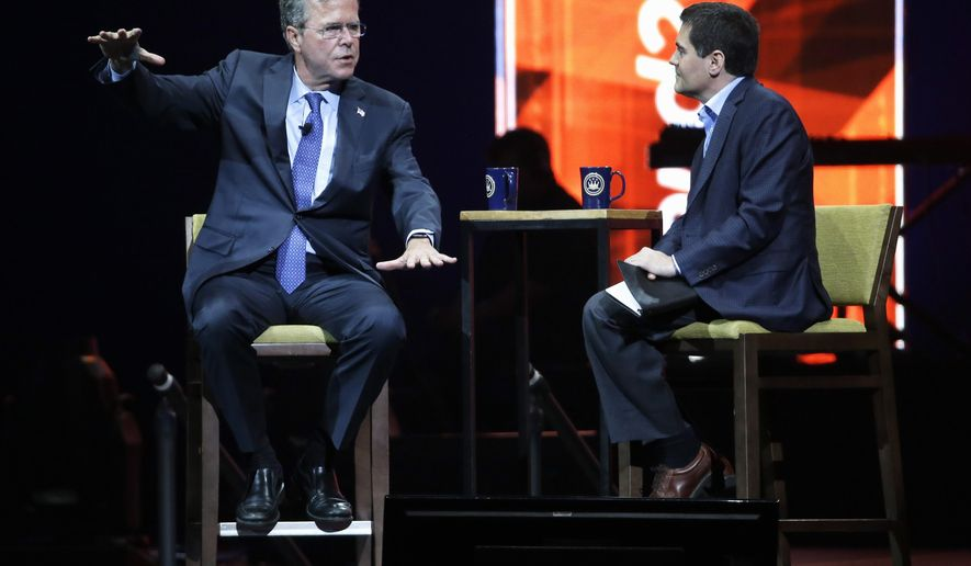 Republican presidential candidate, former Florida Gov. Jeb Bush, left, is interviewed by Dr. Russell Moore at the Send North America Conference, Tuesday, Aug. 4, 2015, in Nashville, Tenn. (AP Photo/Mark Humphrey)