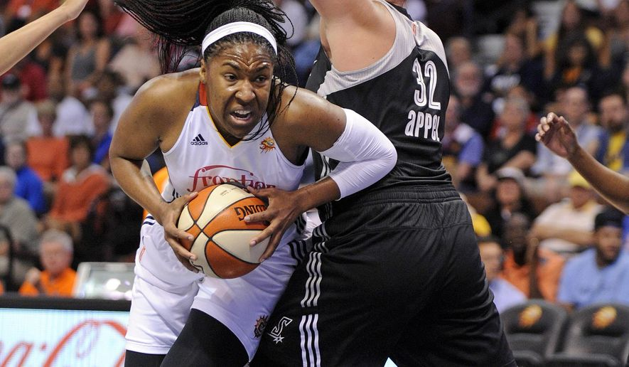 Connecticut Sun's Kelsey Bone (3) drives past San Antonio Stars's Jayne Appel (32) during the first half of a WNBA basketball game in Uncasville, Conn., on Tuesday, Aug. 4, 2015. (AP Photo/Fred Beckham)