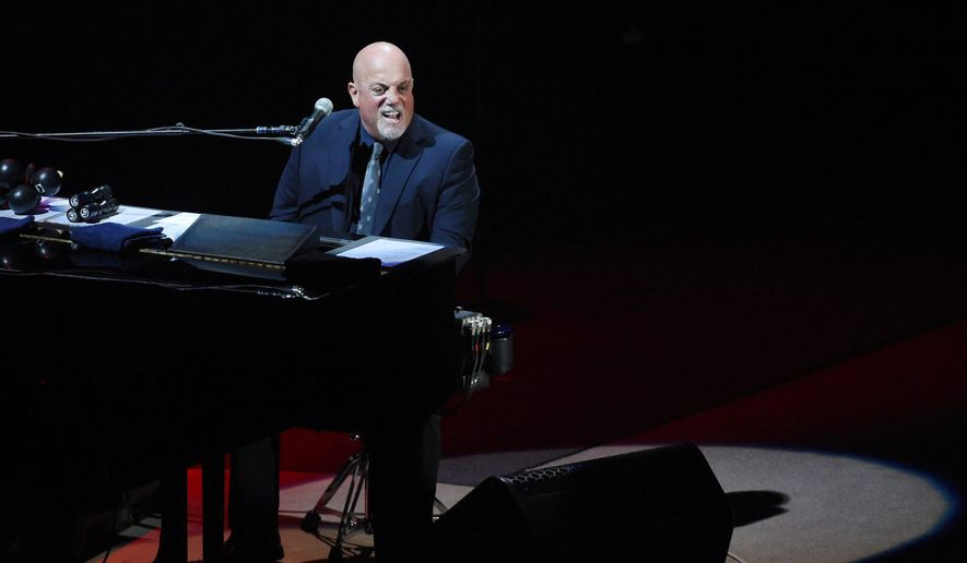 Billy Joel performs at the Nassau County Veterans Memorial Coliseum on Tuesday, Aug. 4, 2015, in Uniondale, N.Y. For the 32nd time, the Piano Man played at the arena before it closes for a major renovation. (Thomas A. Ferrara/Newsday via AP)