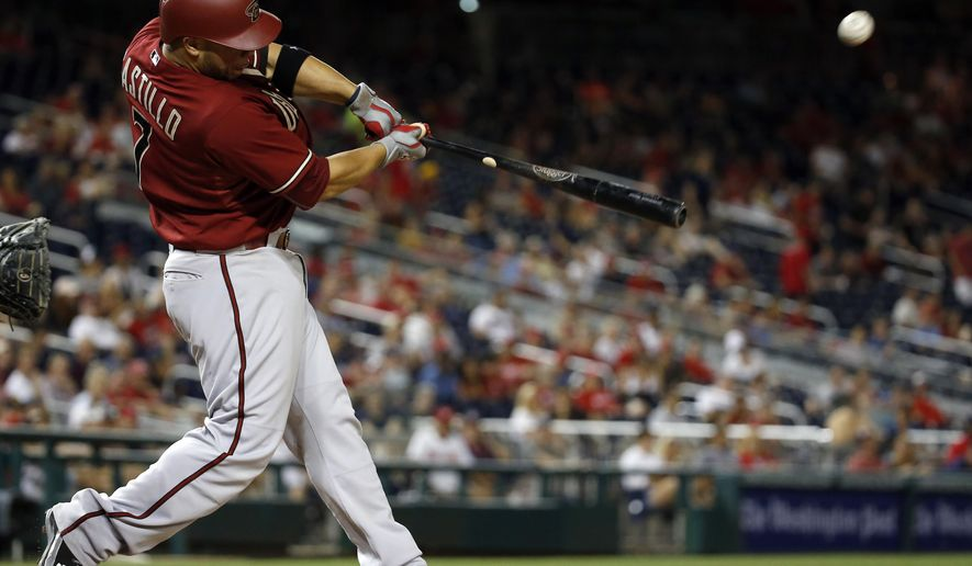 Arizona Diamondbacks' Welington Castillo hits a three-run home run during the eighth inning of a baseball game against the Washington Nationals at Nationals Park, Wednesday, Aug. 5, 2015, in Washington. The Diamondbacks won 11-4. (AP Photo/Alex Brandon)