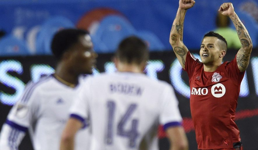 Toronto FC's Sebastian Giovinco celebrates his second goal of the night against Orlando City during the second half of an MLS soccer match, Wednesday, Aug. 5, 2015, in Toronto. (Frank Gunn/The Canadian Press via AP) MANDATORY CREDIT