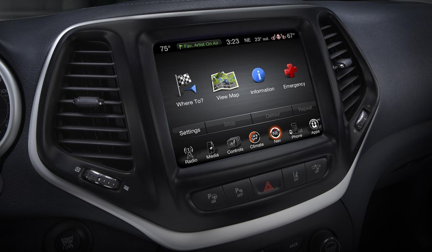 This product image provided by Fiat Chrysler Automobiles (FCA) shows the Uconnect 8.4 inch infotainment system on a 2014 Jeep Cherokee Limited. FCA on Wednesday, Aug. 5, 2015 said that it has a software fix that will prevent future hacking into the Jeep Cherokee and other vehicles. Owners of some 2013 and 2014 model year vehicles with 8.4-inch touchscreen infotainment systems can download the software from FCA's UConnect Web site and install it on their vehicles. (Fiat Chrysler Automobiles via AP)