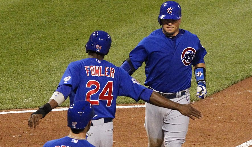 Chicago Cubs' Kyle Schwarber, right, is greeted by teammate Dexter Fowler (24)  after hitting a two-run home run off Pittsburgh Pirates starting pitcher Jeff Locke in the sixth inning of a baseball game against the Pittsburgh Pirates, Wednesday, Aug. 5, 2015, in Pittsburgh. (AP Photo/Gene J. Puskar)