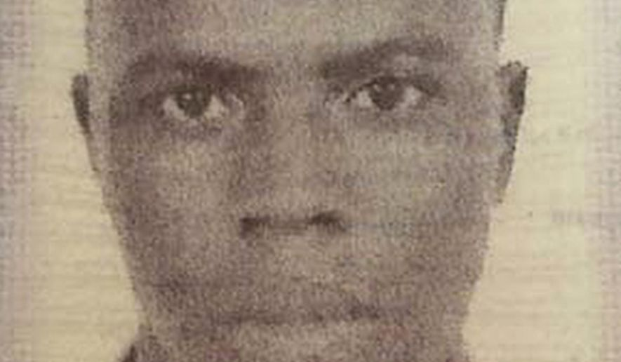 This undated passport photo released by the Inglewood Police Department shows missing Special Olympics athlete Abidjan Ouattara, originally from the Ivory Coast. Ouattara vanished near Los Angeles on Monday, Aug. 3, 2015. (Inglewood Police Department via AP)