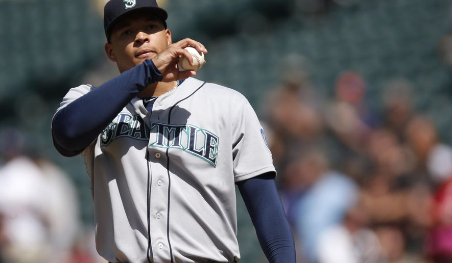 Seattle Mariners starting pitcher Taijuan Walker reacts after giving up a three-run home run to Colorado Rockies' Carlos Gonzalez during the sixth inning of a baseball game Wednesday, Aug. 5, 2015, in Denver. Colorado won 7-5 in 11 innings. (AP Photo/David Zalubowski)