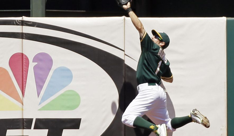 Oakland Athletics center fielder Billy Burns makes a leaping catch at the wall on a fly ball hit by the Baltimore Orioles' Adam Jones during the sixth inning of a baseball game, Wednesday, Aug. 5, 2015, in Oakland, Calif. (AP Photo/Eric Risberg)