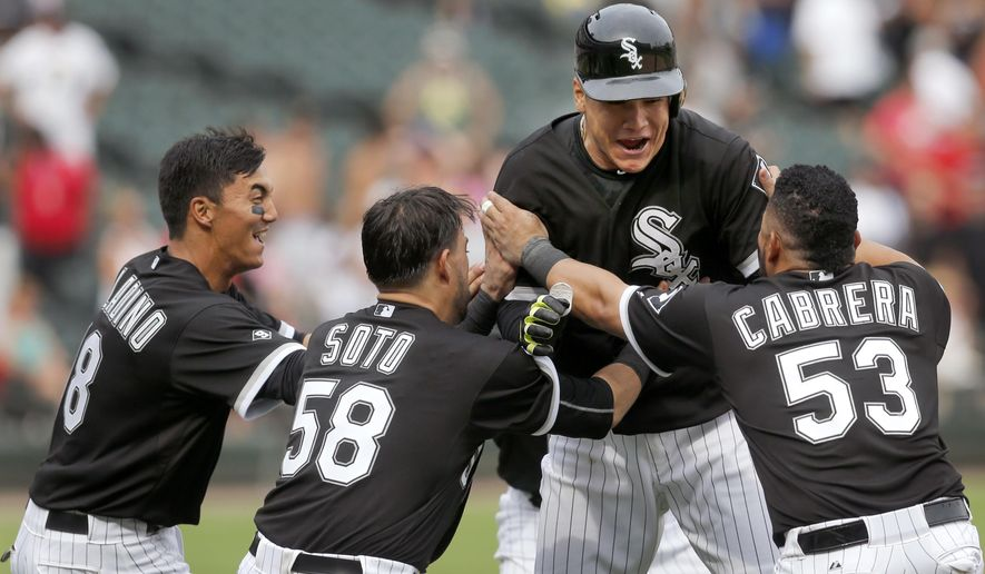Chicago White Sox's Avisail Garcia, center, celebrates with teammates Tyler Saladino, left, Geovany Soto (58) and Melky Cabrera (53) after Garcia drew a bases loaded walk from Tampa Bay Rays relief pitcher Brad Boxberger, scoring Adam Eaton, during the 10th inning of a baseball game, Wednesday, Aug. 5, 2015, in Chicago. The White Sox won 6-5. (AP Photo/Charles Rex Arbogast)