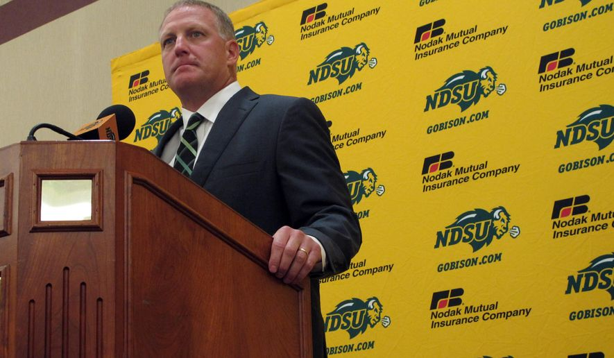 North Dakota State head coach Chris Klieman speaks during the team's NCAA college football media day in Fargo, N.D., Wednesday, Aug. 5, 2015. Klieman is in his second year at the helm of the Bison, who have won a record four straight Football Championship Subdivision titles. They open the season Aug. 29 at Montana. (AP Photo/Dave Kolpack)