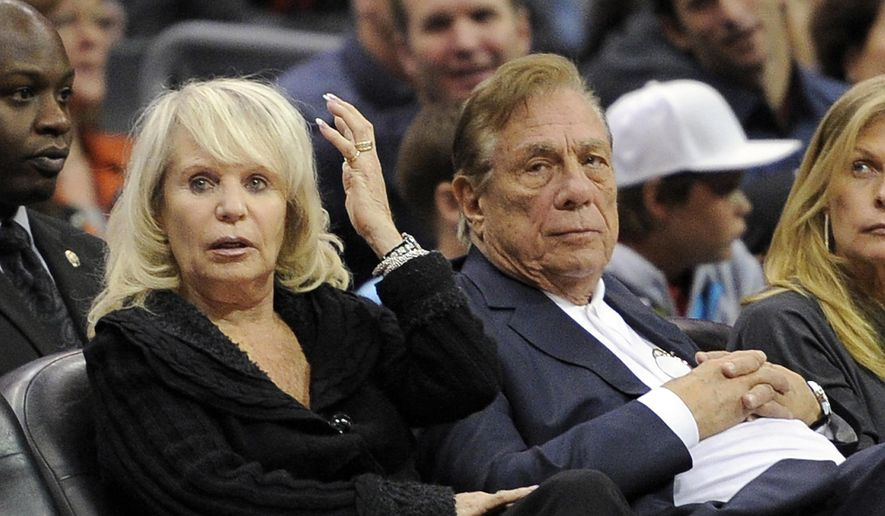 FILE - In this Nov. 12, 2010, file photo, Shelly Sterling, left, sits with her husband, Los Angeles Clippers owner Donald Sterling, during the Clippers' NBA basketball game against the Detroit Pistons in Los Angeles. The former team owner has filed for divorce from Shelly Sterling, his attorney Bobby Samini said Wednesday, Aug. 5, 2015. (AP Photo/Mark J. Terrill, File)