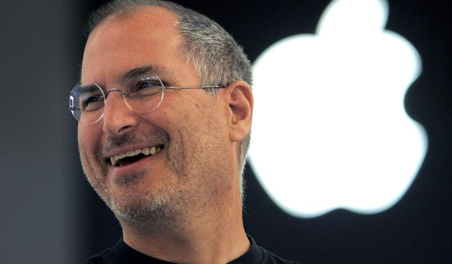 FILE - In this Sept. 20, 2005 file photo, Apple co-founder Steve Jobs smiles after a press conference as he opens the Apple Expo in Paris. Since his death in 2011, Jobs has been the subject of documentaries, books, a film, even a graphic novel. Now the technology pioneer will be the focus of an upcoming opera. In front of the Sangre de Cristo mountains in northern New Mexico, the Santa Fe Opera announced Wednesday, Aug. 5,  that its latest commission will be based on the man who helped revolutionize personal computers, the music business and, of course, brought the world the iPhone.  (AP Photo/Christophe Ena, File)