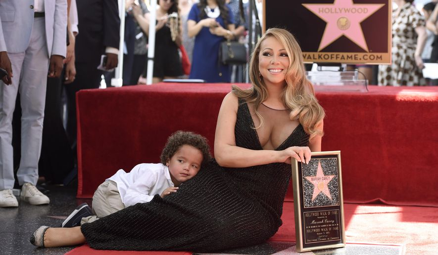 Mariah Carey, right, and her son Moroccan Cannon pose during a ceremony honoring Carey with a star on the Hollywood Walk of Fame on Wednesday, Aug. 5, 2015 in Los Angeles.  (Photo by Chris Pizzello/Invision/AP)