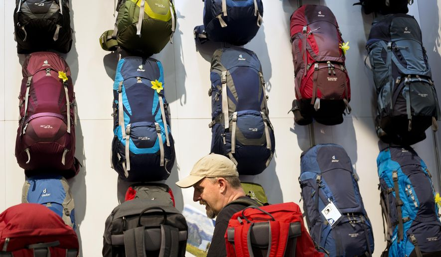 Retail buyer Stephen Korpi talks in front of the Deuter backpack display at the Outdoor Retailer Show on Wednesday, Aug. 5, 2015, in Salt Lake City.  There has been discussion of moving the twice a year event from it's long time home in Salt Lake City. (AP Photo/Kim Raff)