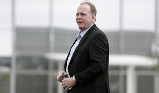 In this Feb. 25, 2015, file photo, baseball broadcast analyst and former Boston Red Sox pitcher Curt Schilling watches as the Red Sox workout at baseball spring training in Fort Myers Fla. Boston Mayor Martin J. Walsh wants to ban chewing tobacco in sports venues across the city. The mayor is expected to discuss a proposed new ordinance Wednesday, Aug. 5. Public health officials, advocates, local youth and Schilling are expected to attend. (AP Photo/Tony Gutierrez, File)