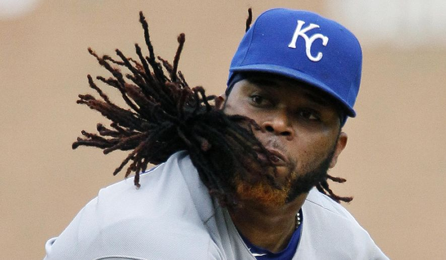 Kansas City Royals' Johnny Cueto pitches against the Detroit Tigers during the first inning of a baseball game at Comerica Park, Wednesday, Aug. 5, 2015 in Detroit. (AP Photo/Duane Burleson)