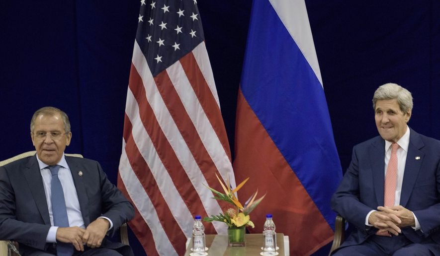 Russian Foreign Minister Sergey Lavrov, left, and U.S. Secretary of State John Kerry sit before a bilateral meeting in Kuala Lumpur, Malaysia, Wednesday, Aug. 5, 2015. (Brendan Smialowski/Pool Photo via AP)