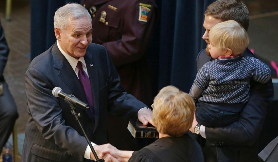 FILE - In this Jan. 5, 2015 file photo, Minnesota Gov. Mark Dayton, left, is congratulated by Chief Justice Lorie Skjerven Gildea, one of his son's and grandson, Hugo, during his inauguration ceremony in St. Paul, Minn. After easily securing a second term as Minnesota governor last fall, Democrat Mark Dayton landed sizable checks toward his early-January inauguration, including some from companies whose leaders favored the GOP nominee in the race. (AP Photo/Jim Mone, File)