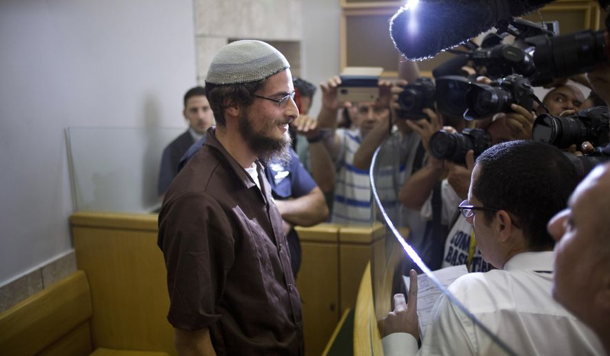 "Head of a Jewish extremist group Meir Ettinger appears in court in Nazareth Illit , Israel, Tuesday, Aug. 4, 2015. Israel said Tuesday it was interrogating the suspected head of a Jewish extremist group in the first arrest of an Israeli suspect following last week's arson attack in the West Bank that killed a Palestinian toddler and wounded his brother and parents. According to the Shin Bet security agency, 23-year-old Ettinger was arrested late Monday for ""involvement in an extremist Jewish organization."" (AP Photo/Ariel Schalit)"